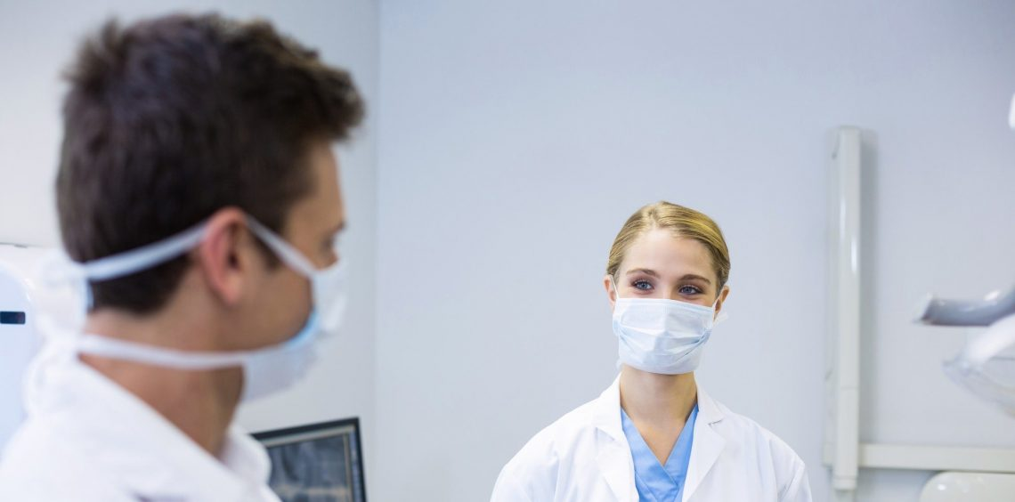 Dentists wearing surgical mask